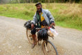 Man with fish on bycicle at gravel road june gulf province papua new guinea Royalty Free Stock Photo