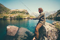 Man Fisherman fishing with rod alone Royalty Free Stock Photo