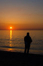 Man fishing in barcelona silhouette of a at sunrise Stock Photos
