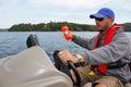 Man Fishing In Boat Marker Buo...