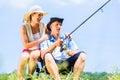 Man with fishing rod angling at lake enjoying hug Royalty Free Stock Photo