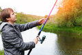 Man with fishing rod on the shore of river Royalty Free Stock Photo