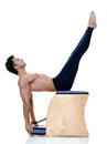 Man fitness pilates exercices one caucasian exercising on white background Royalty Free Stock Photography