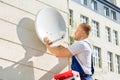 Man Fitting TV Satellite Dish Royalty Free Stock Photo