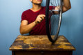 Man fixing bicycle tyre worker is a tire Stock Photography