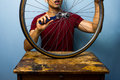 Man fixing bicycle tyre worker is a tire Stock Image
