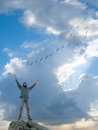 A man and flight of flying birds Stock Images