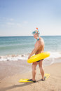 Man in flippers and mask on the bank of the sea Royalty Free Stock Photography