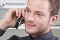 Man flirting on phone the at work Stock Photography