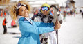 Man flirting with woman holding snowboard Royalty Free Stock Photo