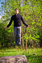 Man floating in the forest happy middle of nature Stock Image
