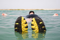 Man floating on water with shoes Royalty Free Stock Photo