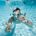 Man floats in pool Royalty Free Stock Photo