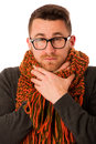 Man with flu and fever wrapped in scarf has terrible sore throat