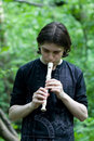 Man with a flute Stock Photography