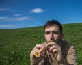 Man with a flute young in meadow Royalty Free Stock Photos