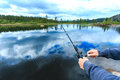 Man fly-fishing in Norway Royalty Free Stock Photo