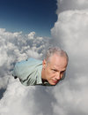 A Man Flying Through the Clouds Royalty Free Stock Photo