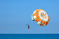 Man flying parasailing in a blue sky Royalty Free Stock Photo