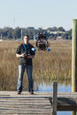 Man flying unmanned drone with video camera Royalty Free Stock Image