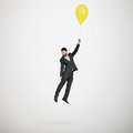 Man flying with yellow balloon Royalty Free Stock Photo