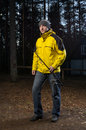 Man in the forest portrait of adult caucasian yellow jacket with fishing rod Stock Images