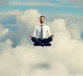 Man in formal wear meditating in the sky happy businessman Stock Photos