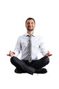 Man in formal wear practicing yoga calm businessman isolated on white background Stock Images