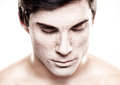 Man with foundation a handsome male model a make up on his face Stock Photos