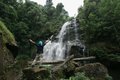 Man freedom in natural water fall in Jungle