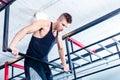 Man at freestyle Calisthenics training in gym Royalty Free Stock Photo