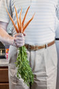 Man with Fresh Carrots Stock Images