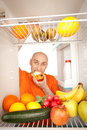 Man and fridge Stock Photography
