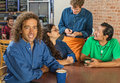 Man with friends and barista grinning men at cafe Stock Photography