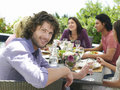 Man with friends having meal outdoors portrait of handsome young men Royalty Free Stock Photo