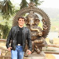 Man in front of ganesha young standing hindu hinduist god with head elephant Royalty Free Stock Image