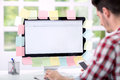 Man front of monitor with lot of sticky notes Royalty Free Stock Photo