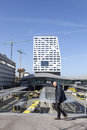 Man in front of new bus station and city office utrecht seen fro