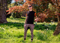 Man in front of a tree in park cool the with sunglasses Stock Photography