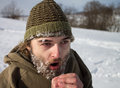 A man with frozen beard portrait of freezing in winter Royalty Free Stock Images