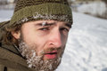 A man with frozen beard portrait of in winter Stock Photo