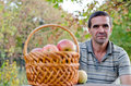 Man with fruit basket Stock Photo