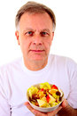 Man with a fruit salad middle aged holding fresh Stock Photos