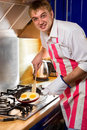 Man frying eggs Stock Photography