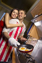 Man frying eggs for his girlfriend Royalty Free Stock Photos