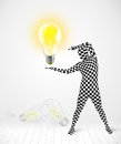 Man in full body with glowing light bulb funny suit new idea concept Royalty Free Stock Photos
