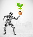 Man in full body suit with eco plant funny ecological concept Stock Photos
