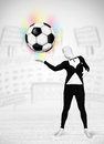 Man in full body suit holdig soccer ball