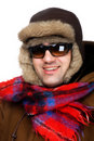 Man in fur hat with sunglasses macro Stock Image