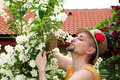 Man in garden smelling flowers Royalty Free Stock Image
